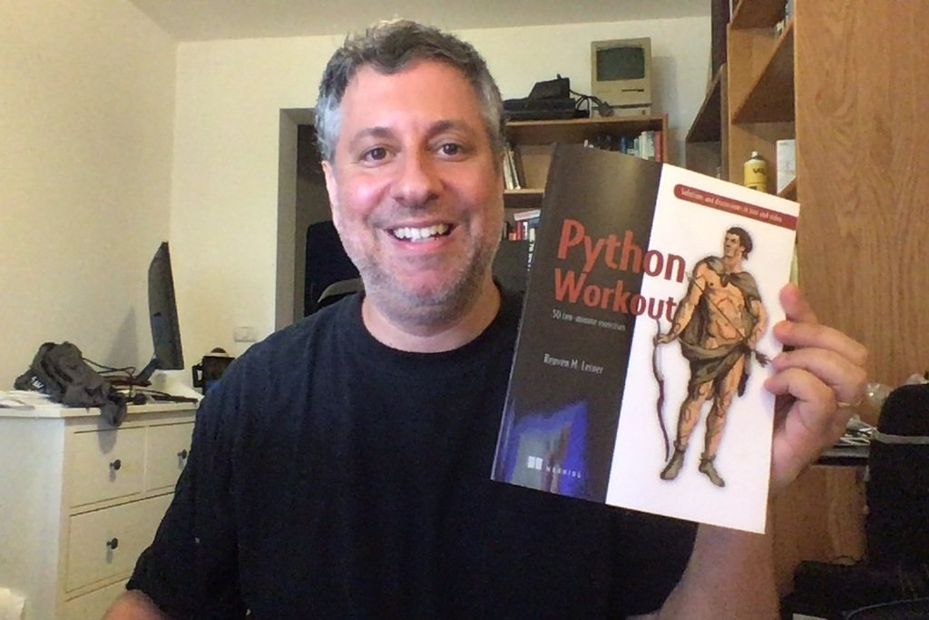 "Reuven Lerner holds a printed copy of ""Python Workout"""